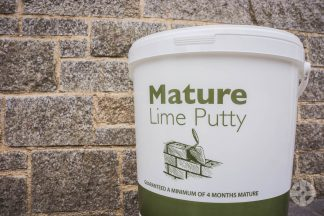 Mature Lime Putty against pointed wall