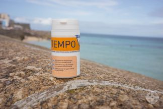 Tempo on harbour wall